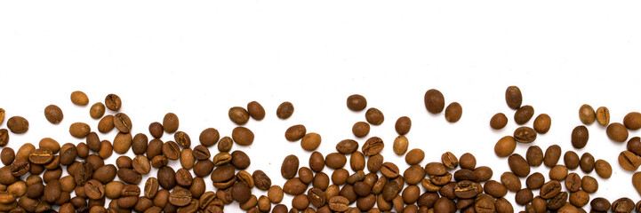 Coffee grains in the bottom of the image on a isolated white bac
