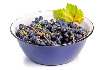 Bowl of grapes on a white background. Isolation