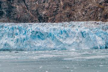 Alaska glacier front in Glacier Bay National Park. Blue Ice global warming. USA travel destination.