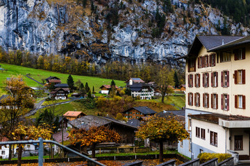 Wall Mural - Alpine meadows and rural houses chalets with red roofs in the Swiss Alps