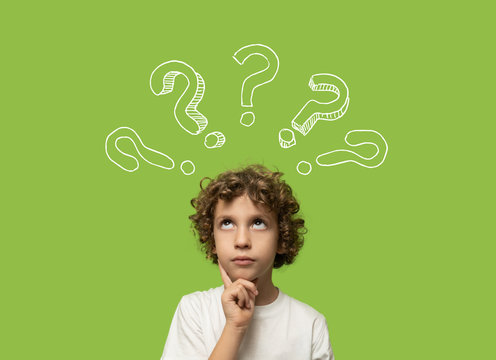 thinking kid - 6 years old child thinking and asking himself a question. Isolated on green background and question mark over his head
