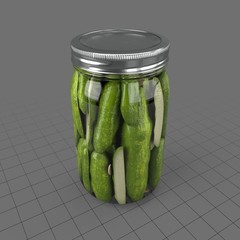Jar filled with pickled cucumbers
