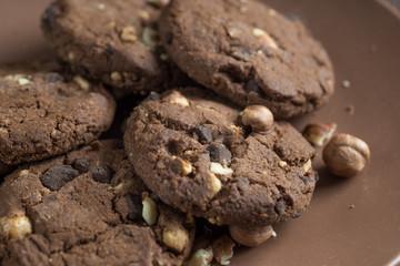 Soft dark chocolate brownie cookies on wood