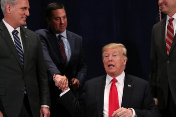 U.S. President Donald Trump shakes hands with Representative Nunes after signing a presidential memorandum focused on water policy in California's Central Valley, at a conference center in Scottsdale, Arizona