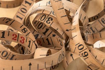 A Vintage measuring tape piled