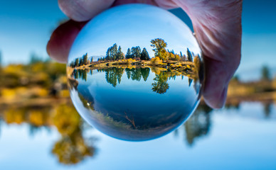 A lensball produces an image of a local trout pond that turns into a reflection pool on this calm autumn day in October.