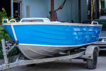 Paint the boat in blue and white.