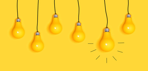 Wall Mural - Many hanging light bulbs on a yellow background