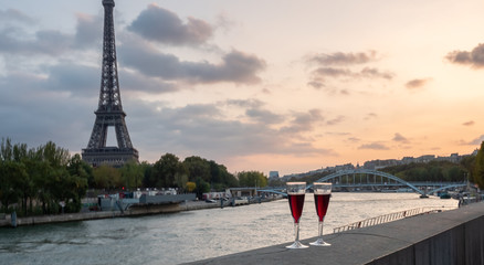 Tow Glasses of Wine on By the Siene River in Paris at Sunset