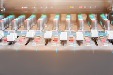 Close up Volume adjusting knobs old on audio mixer controller in control room