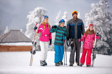 skiing -family enjoying in winter vacation in mountains