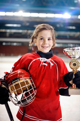 portrait of girl player ice hockey winner trophy.