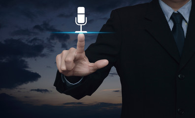 Businessman pressing microphone flat icon over sunset sky, Business communication concept