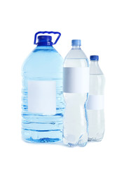 Different bottles of pure water with blank tags on white background