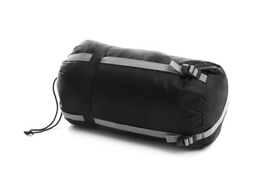Sleeping bag in case on white background. Camping equipment