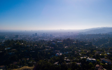Aerial view of the Los Angeles Hollywood district and Walk of Fame with many private homes and parks.