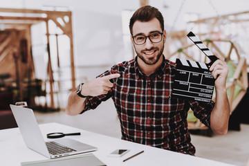 Glasses. Movie Clapper. Ideas. Light Bulb. Laptop.