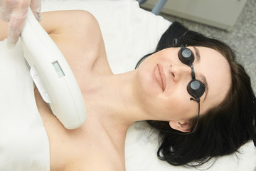 Hair laser removal service. IPL cosmetology device. Professional apparatus. Woman soft skin care
