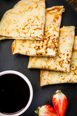 Crepes with strawberries and jam