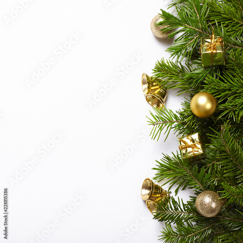 Fir Tree Branches And Christmas Decorations On White Background