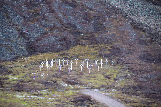 The white crosses of the historic graveyard cemetery, built in 1918 after miners died of the Spanish flu, in Longyearbyen, Spitsbergen, Svalbard, Norway.