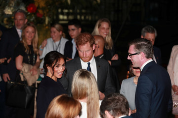Britain's Prince Harry and Meghan, Duchess of Sussex, attend a reception at the Opera House's Bennelong Restaurant in Sydney