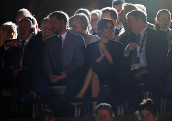 Britain's Prince Harry and his wife Meghan, Duchess of Sussex, attend the opening ceremony of the Invictus Games at the Sydney Opera House, Sydney