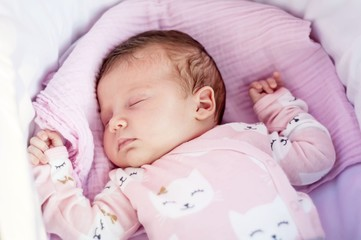 Sweet Caucasian newborn baby sleeping in the cradle or baby carriage. Baby sleep concept stock image.