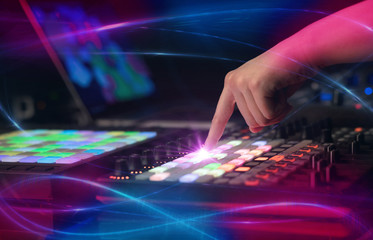 Hand mixing music on midi controller with wave vibe concept