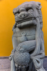 Stone sculpture of a male chinese guardian lion (Shanghai, China)