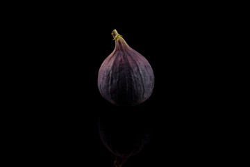 Fig, purple fig isolated on black background, reflections, centered
