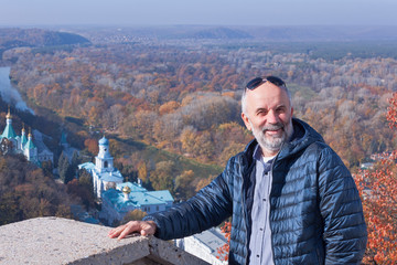 Mature man at the observation deck over Sviatohirsk Lavra