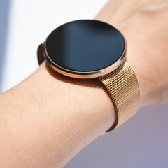 Gold digital watch with a large display on the girl's hand