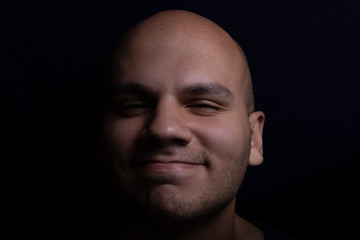 Portrait of Bald Man on Black Background