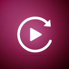 Video play button like simple replay icon isolated on purple background. Flat design. Vector Illustration