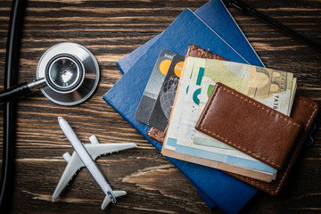 Medical tourism concept - passports, stethoscope, airplane, money top view Wall mural