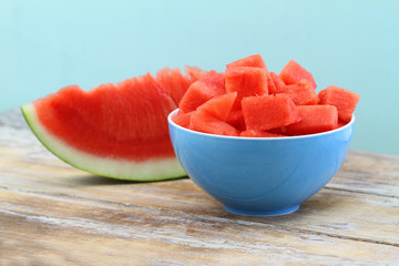 Pieces of freshly sliced watermelon in porcelain bowl