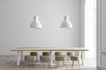 White dining room interior, long table