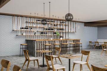 Interior of gray brick bar and restaurant