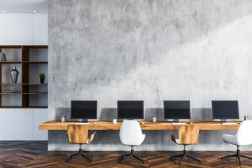 Original concrete walls startup office interior