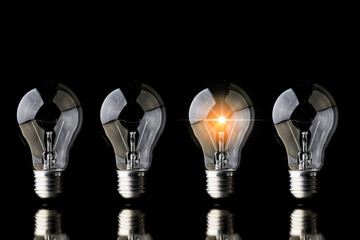creativity startup business ideas concept with glow light bulb on black background Wall mural