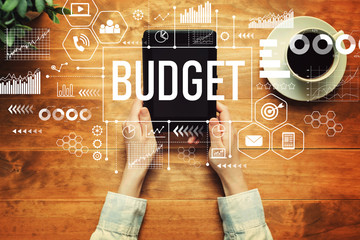 Obraz Budget with a person holding a tablet computer - fototapety do salonu