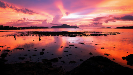 Beautiful light dramatic sky scenery over tropical sea with reflexion in the water,beautiful sunrise at phuket thailand.