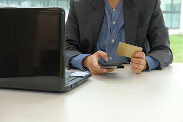 man holding credit card using smart phone for online shopping. businessman purchasing, make payment on internet