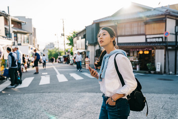 beautiful traveler crossing the road