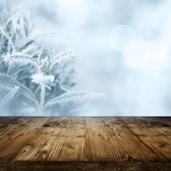 Ice flowers with wooden table in winter