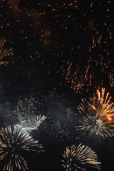 Texture of fireworks in the night sky. Bright lights in St. Petersburg. Red smoke and flashes