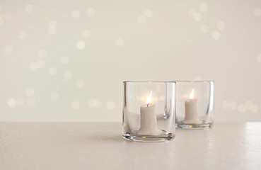 Couple Of Glass Cup Light Candles, 3D rendering.