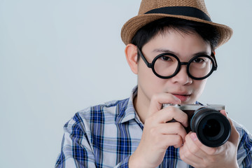 curious glasses asiasn man with summer costume hand hold camera find something white background