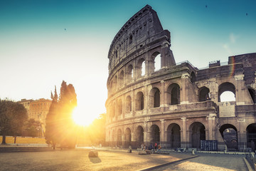 Colosseum in Rome, Italy, at sunrise. Colourful travel background.